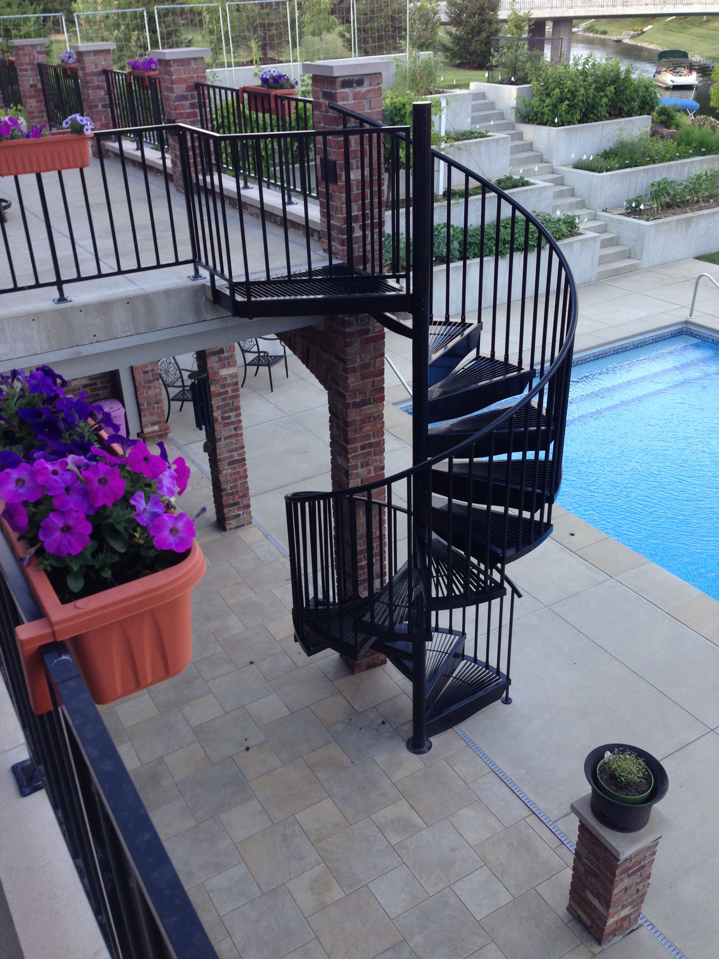 Best Aluminum Powder Coated Spiral Stair On A Poolside Deck 400 x 300