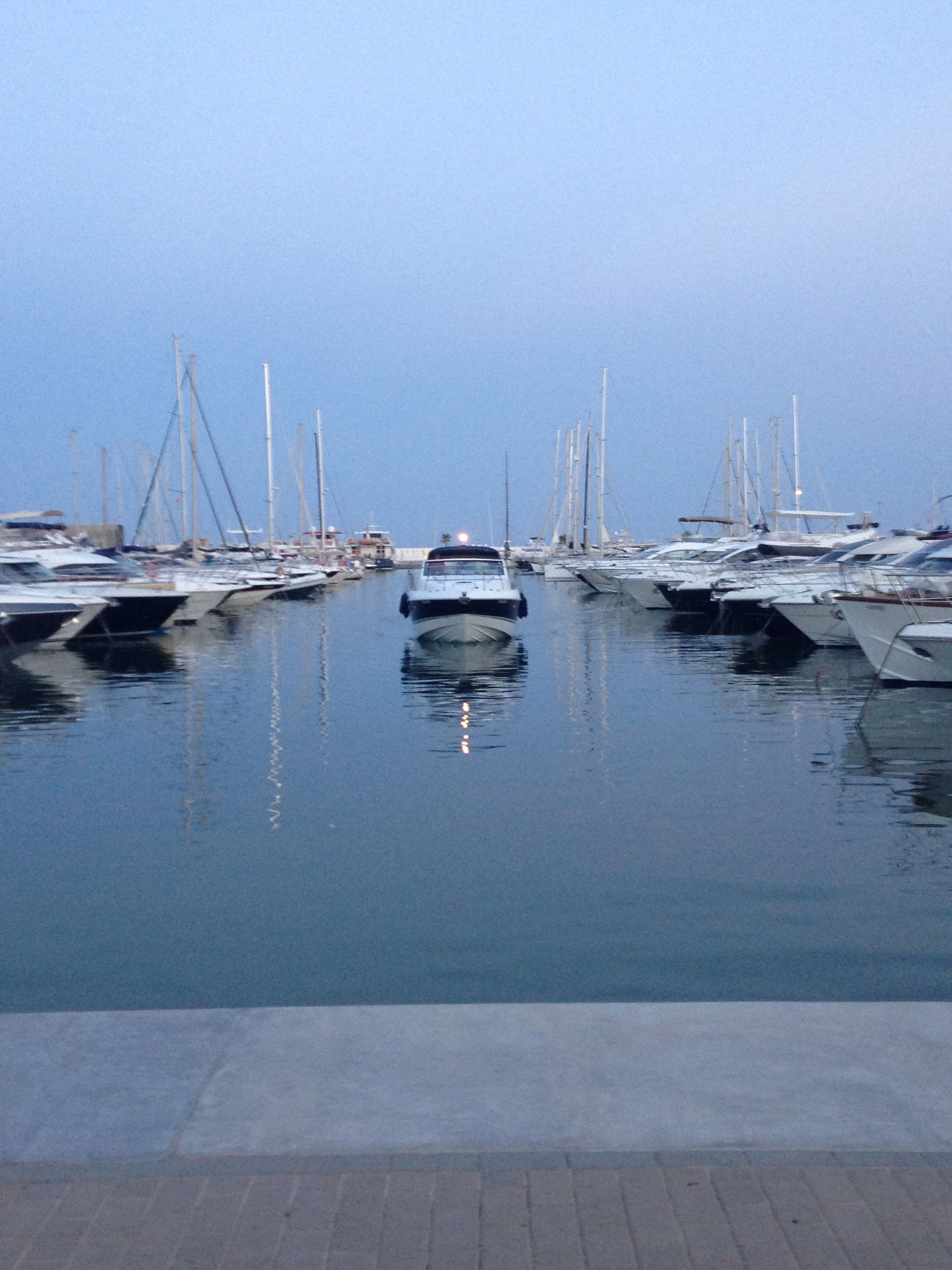 Santa Eulalia Marina, Ibiza - yachts, sea, boats, photography, sunset, symmetry (photograph by Yasmin Stopford)