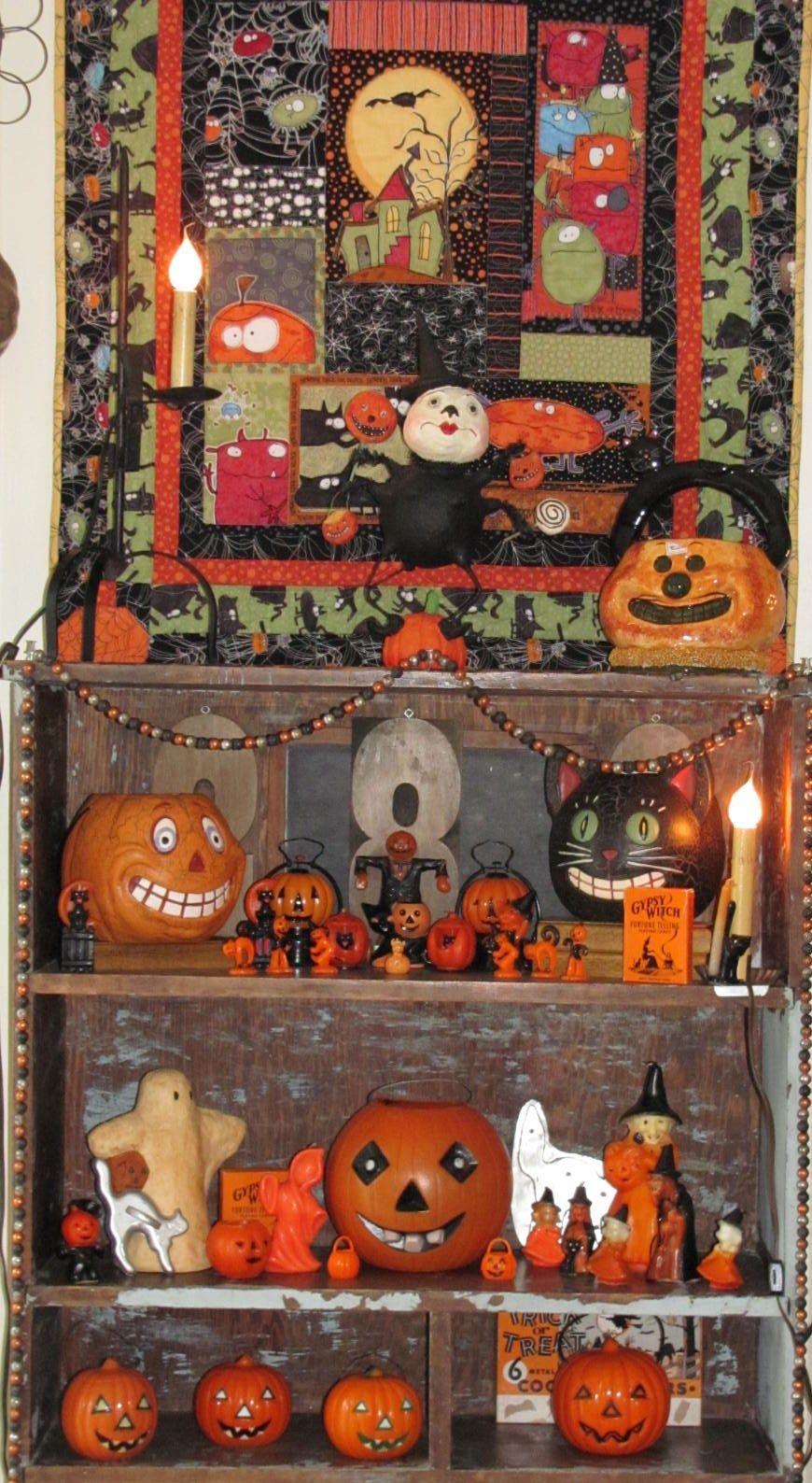 Vintage halloween display in old cupboard. We have one of