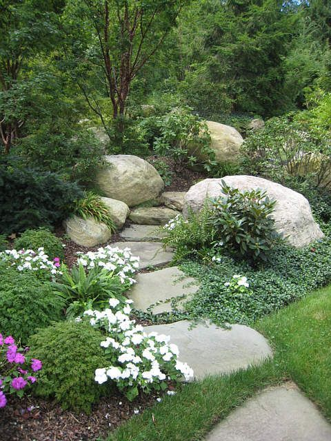 Photo of I like the idea of the boulders and bushes hiding where the path is leading. It …