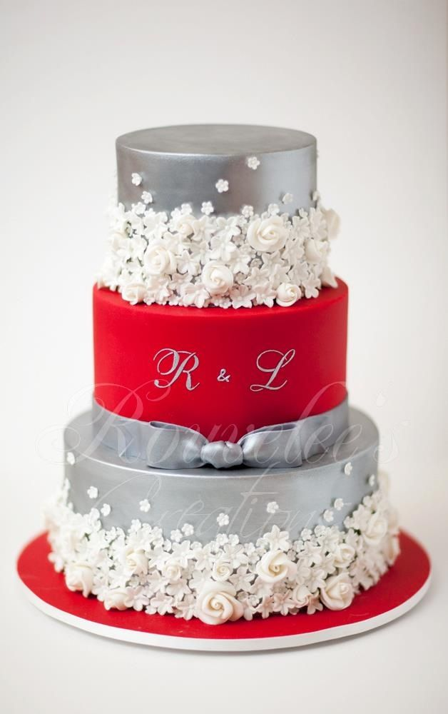 Red And Silver Cake With White Flowers