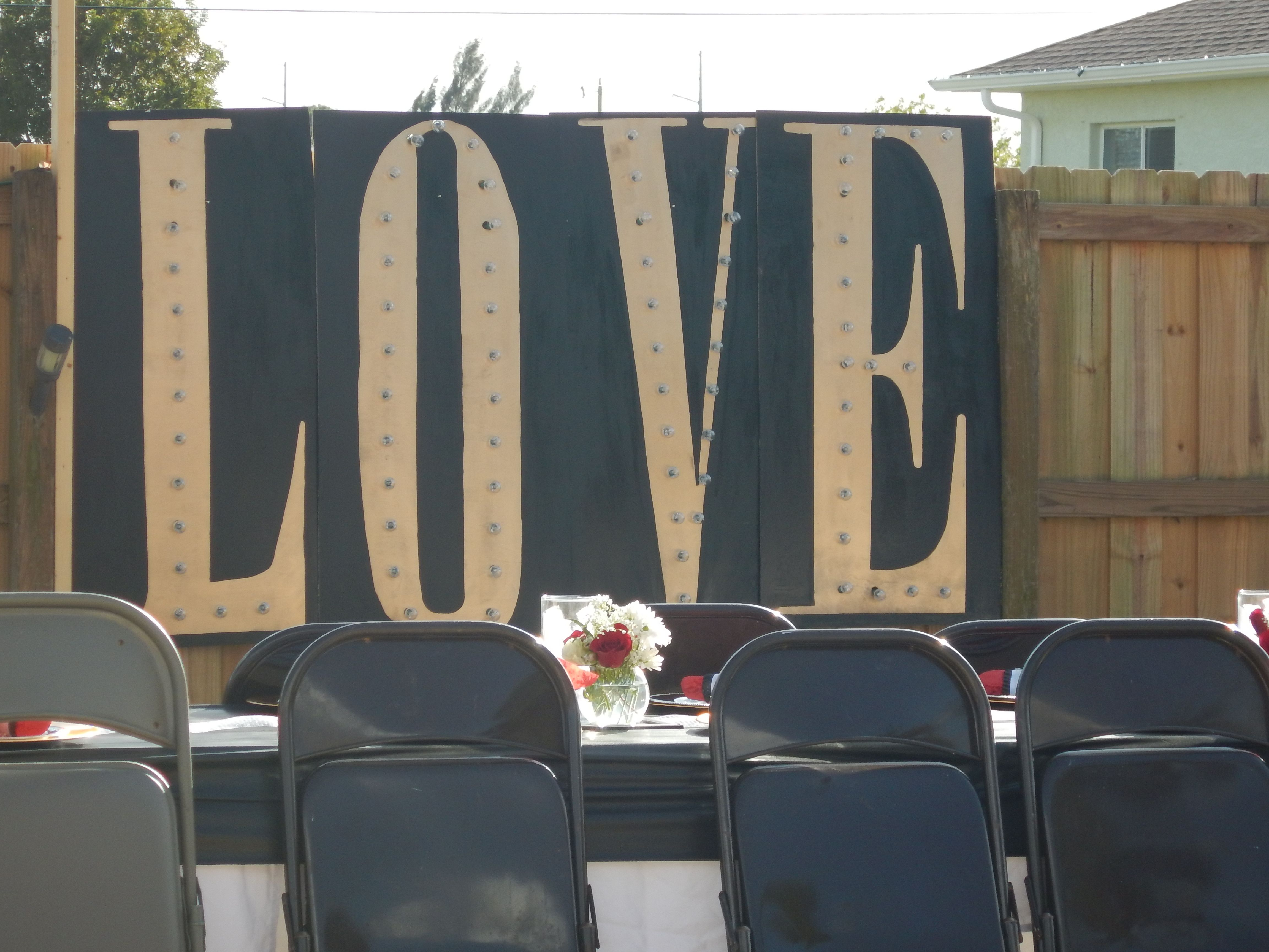 light up love sign old hollywood glam backyard wedding reception
