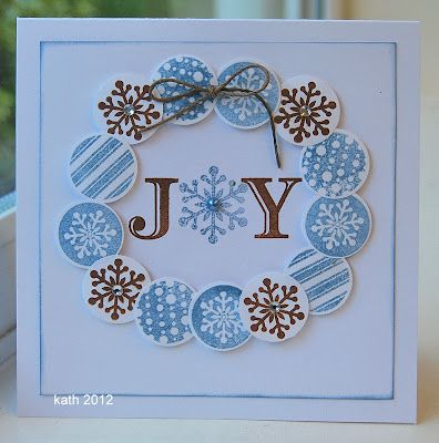 a wreath of stamped and punched circles, all the same size, adorns this lovely winter/Christmas card...