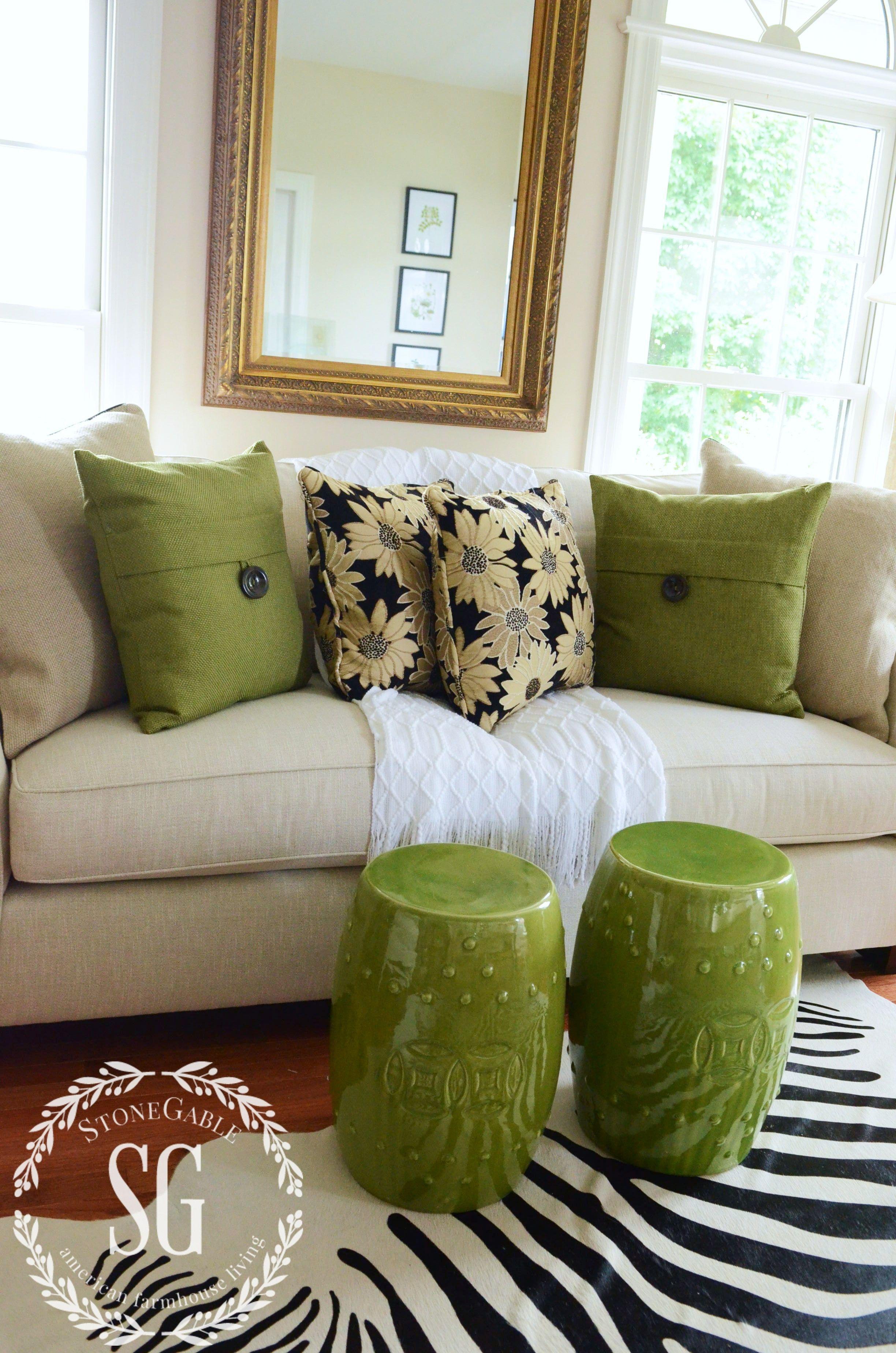 5 No Fail Tips For Arranging Pillows Stonegable Sofa Pillows Arrangement Sofa Styling Living Room Colors