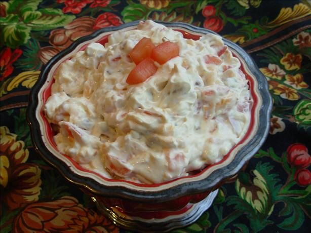 """Awesome Bacon-Tomato Dip from Food.com: Oh, you HAVE to try this one!! My family LOVES dips and spreads, and even the guys got really into this one. I even caught my uncle (who thinks guys are too """"macho"""" for dips), eating it straight from the bowl with a spoon!! Best when made day of, and lettuce added just before serving. It gets soggy:("""