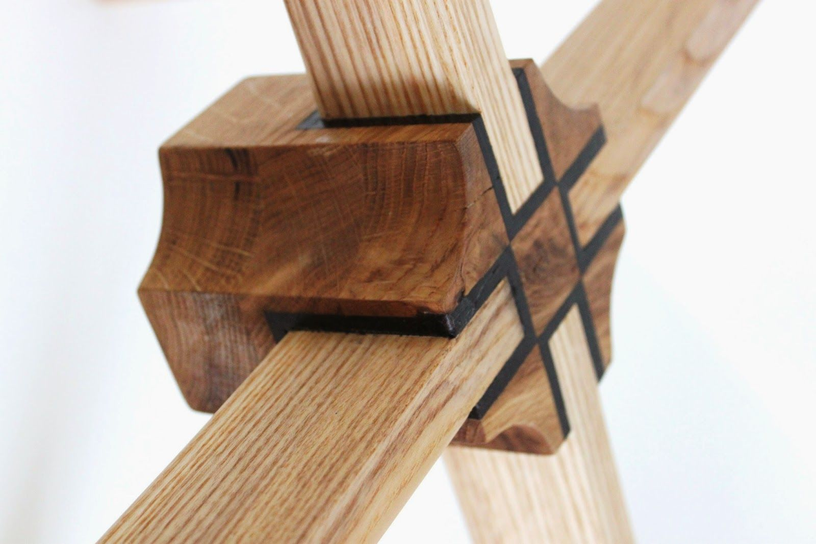Furniture. Zee Chilufya's design for a glass topped table was based on the form of a simplified spider. With walnut and oak inlaid detail on the central apex joint.