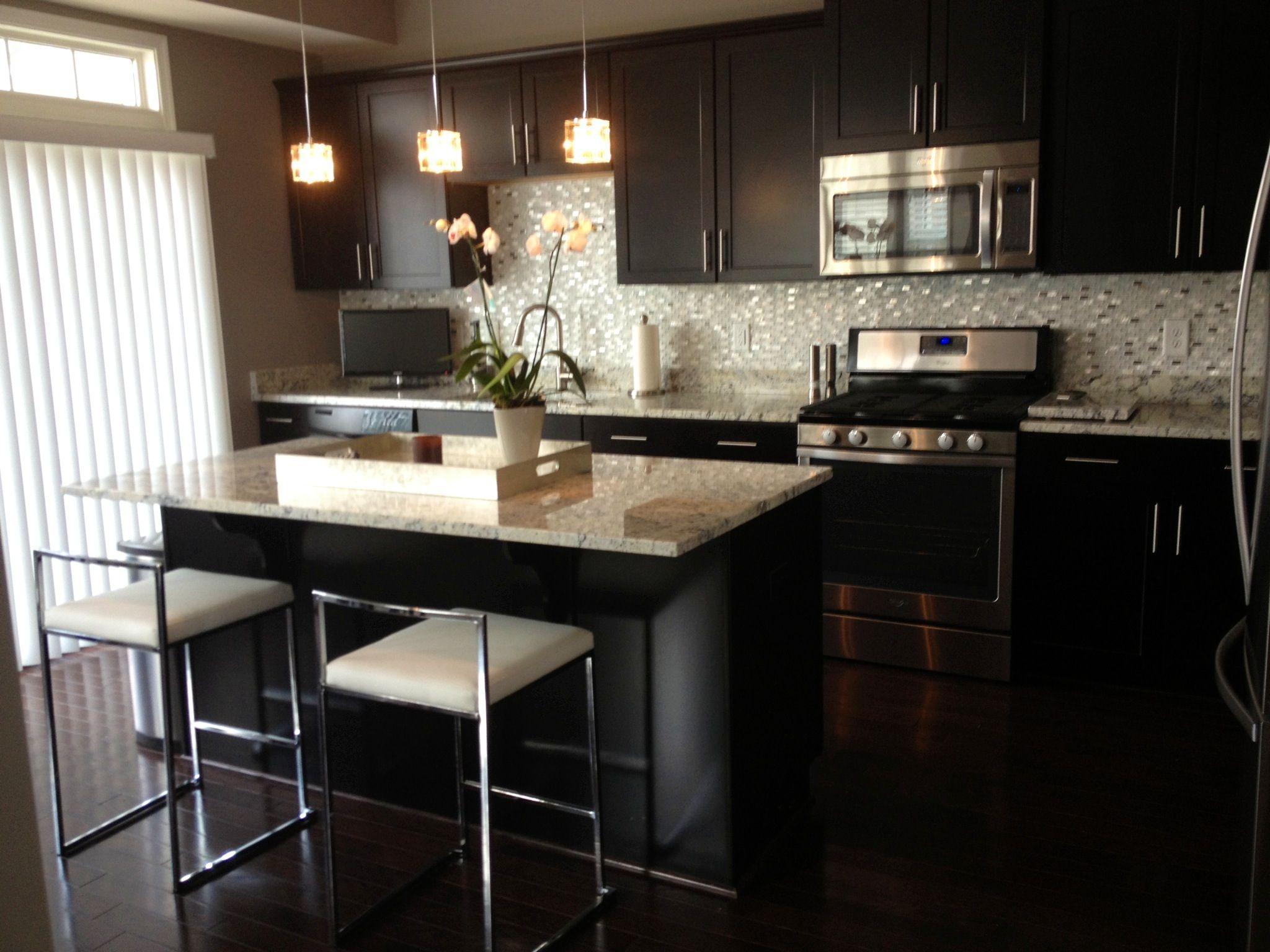 Modern Kitchen Dark Cabinets And Floors Glass Stainless