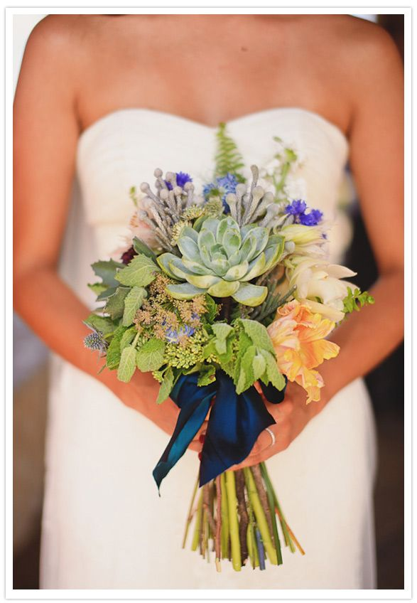succulents, mint, blue thistle and of course cotton. brilliant idea to reuse all of our bouquets to decorate the dessert table during the reception