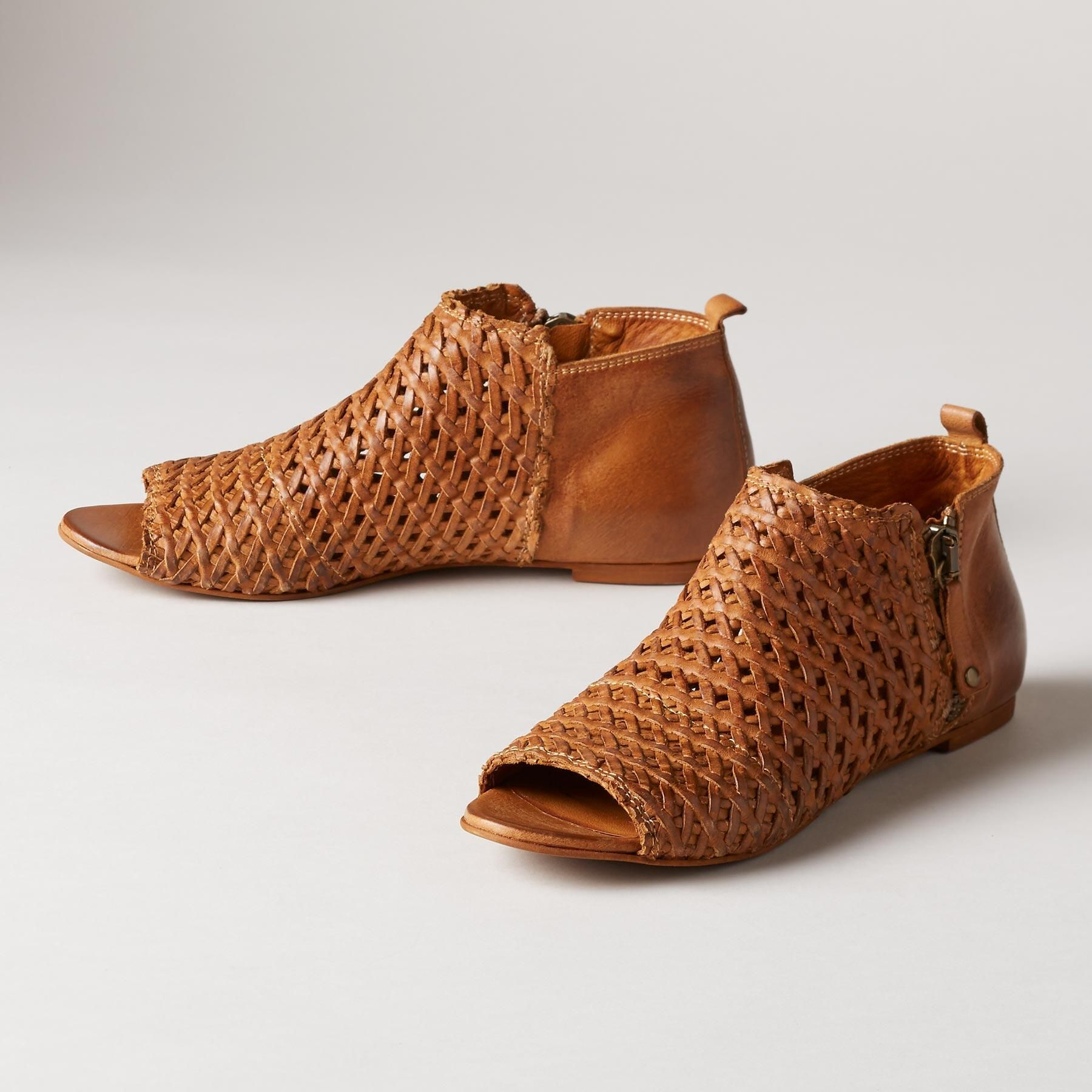 34df45b209de ASHEVILLE SANDALS -- Our woven leather peep-toe shoes bring a timeless  quality to a perfectly-of-the-moment silhouette. Leather. Imported.  Exclusive. Euro ...