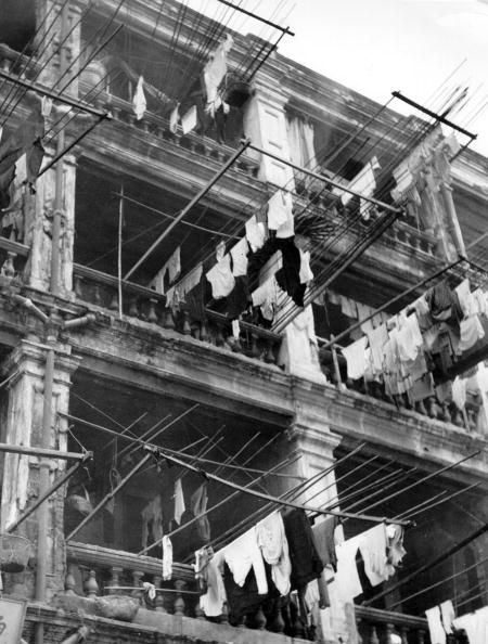29th October 1949: Laundry hanging out on washing-poles from a building in Kowloon, Hong Kong. Original Publication: Picture Post - 4888 - Hong Kong The Waiting Days - pub. 1949 (Photo by Haywood Magee/Picture Post/Getty Images)