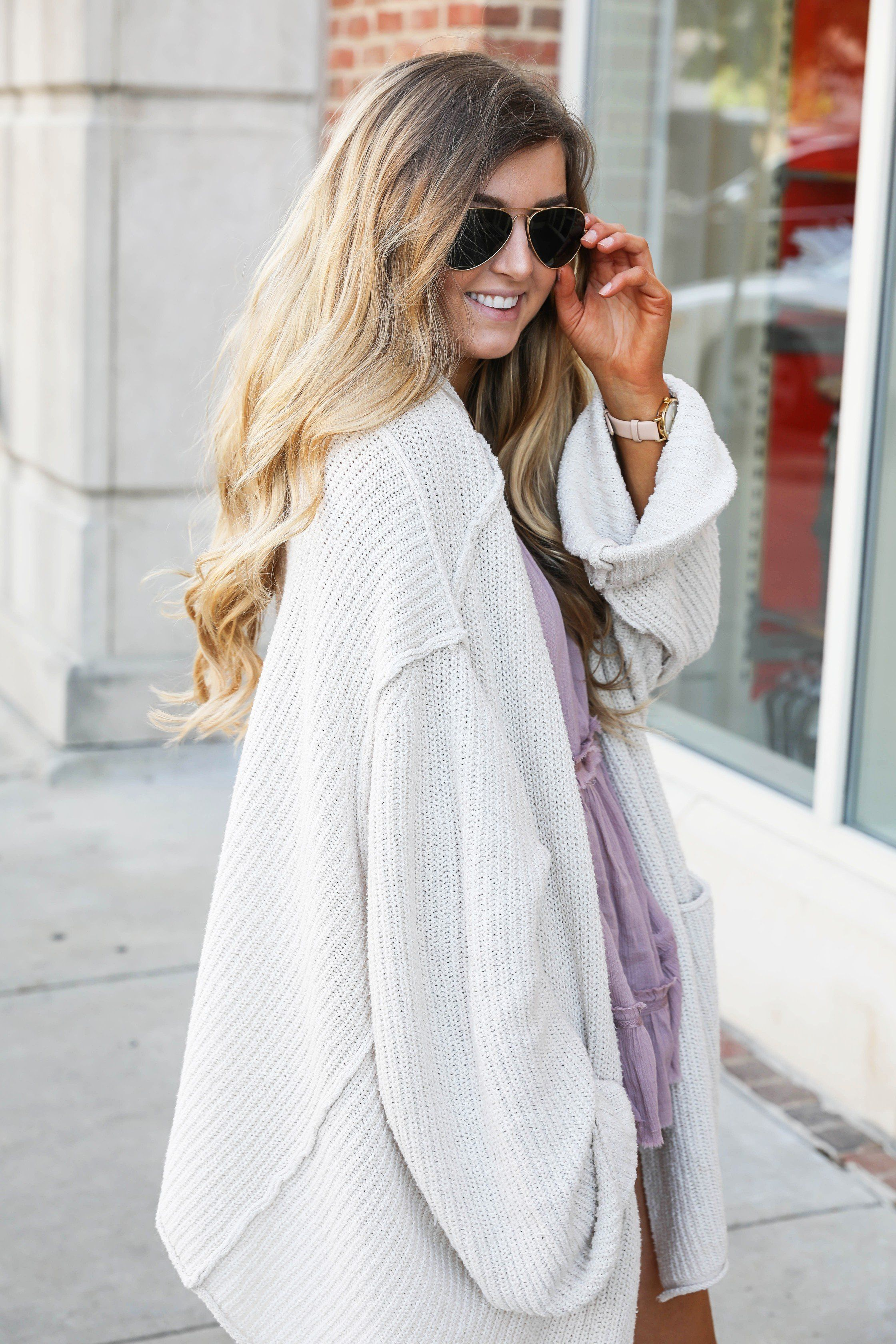 The perfect spring outfit! A purple flowy top paired with a ...
