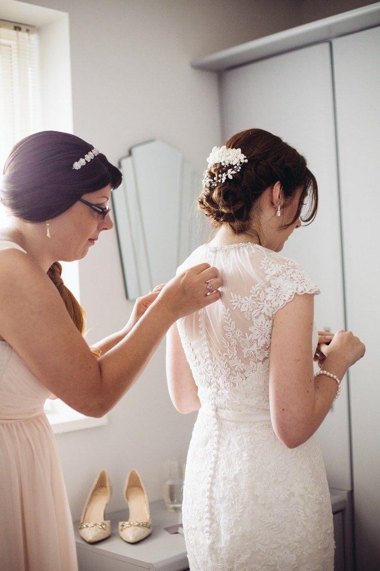 Sheer Lace Button Dress Back Gown Bride Bridal Timeless Rainy Pastel DIY Wedding http://www.catlaneweddings.com/