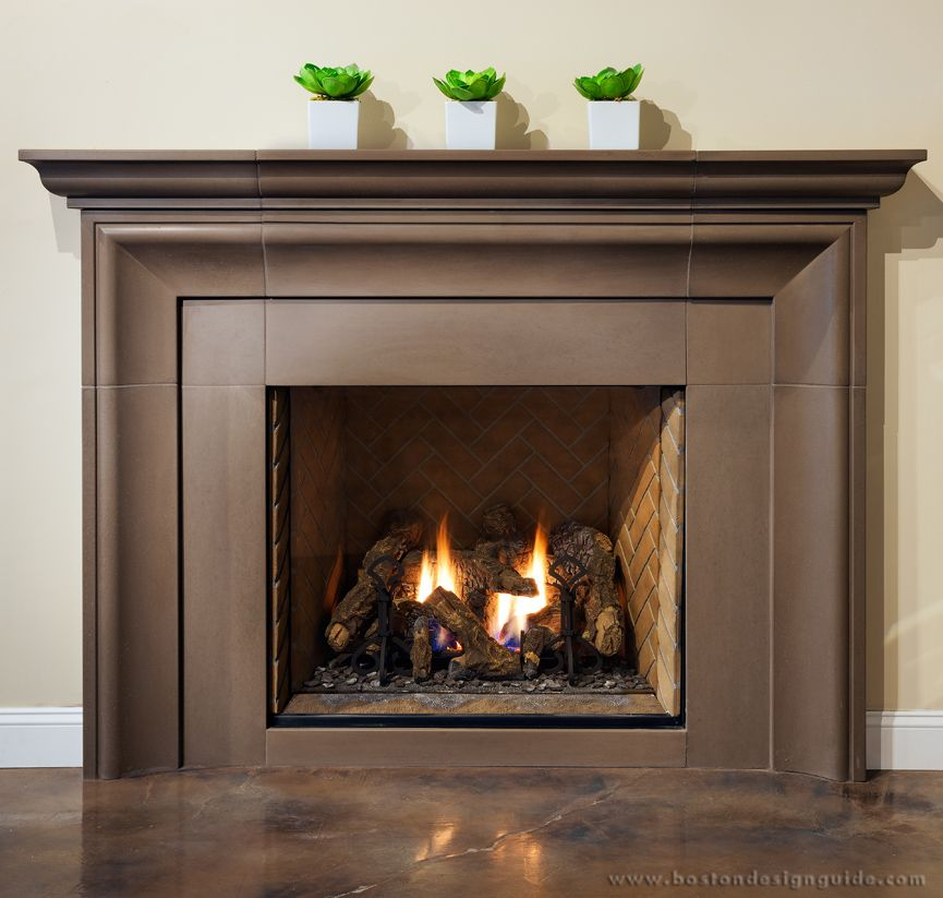 Kozy Heat gas fireplace with a Solus Décor hand-cast concrete ...