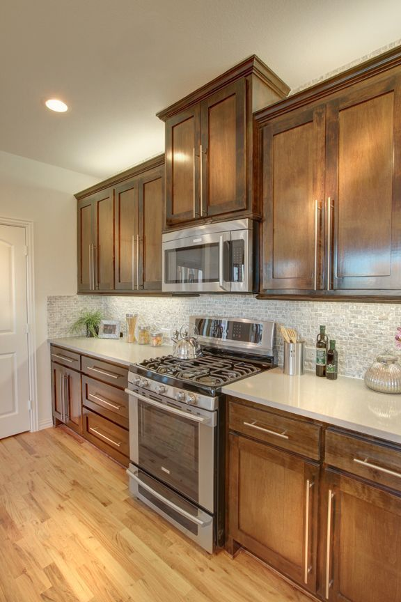 Pecan Wood Kitchen Cabinets Park Now Open In Mckinney Tx Stove And