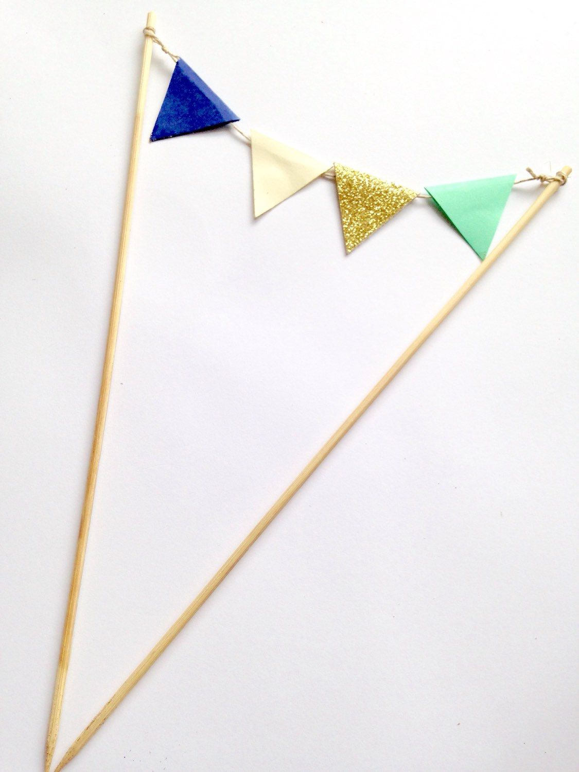 A personal favorite from my Etsy shop https://www.etsy.com/listing/234640885/flag-bunting-cake-topper