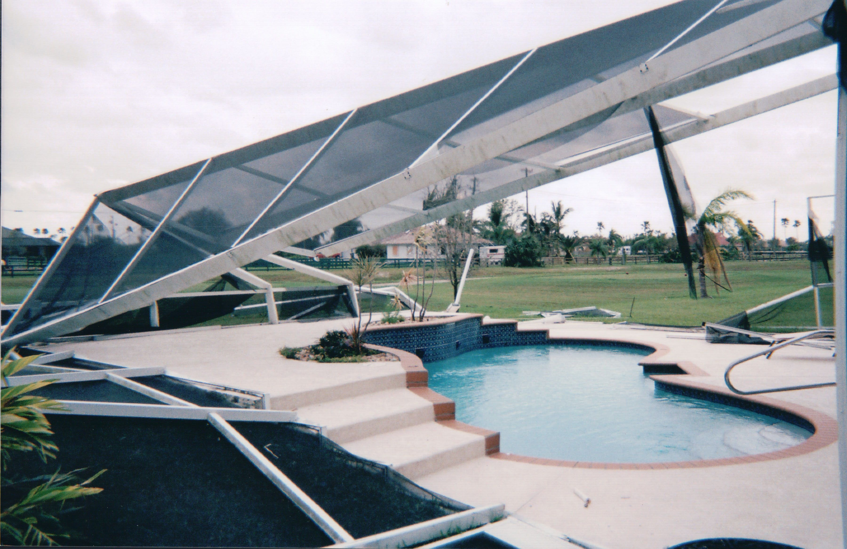 This Pool Screen Enclosure Was Ripped Off The House Screen Enclosures Pool Screen Enclosure Pool