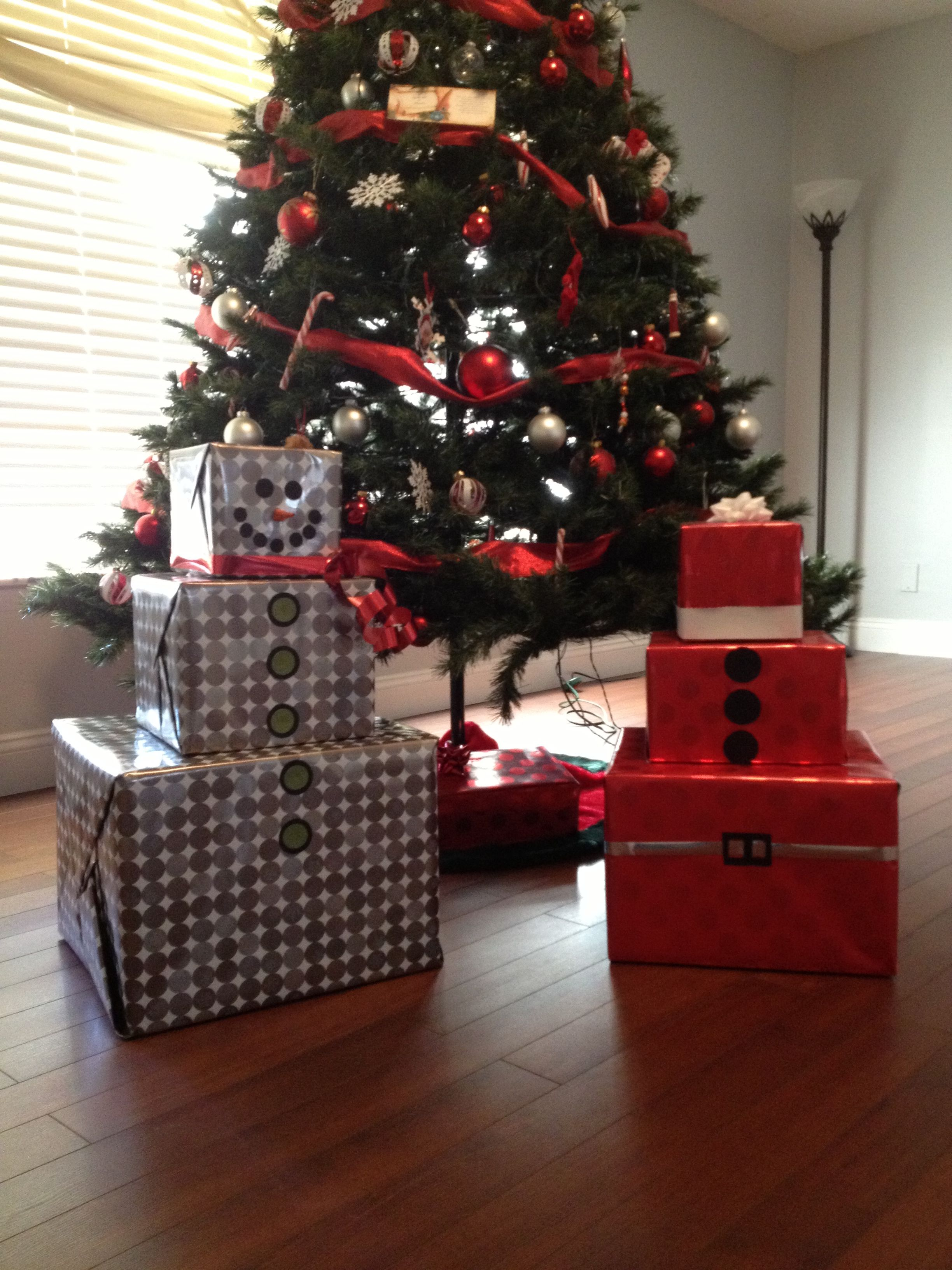 The boys gifts turned into Santa & snowman gift wrapped