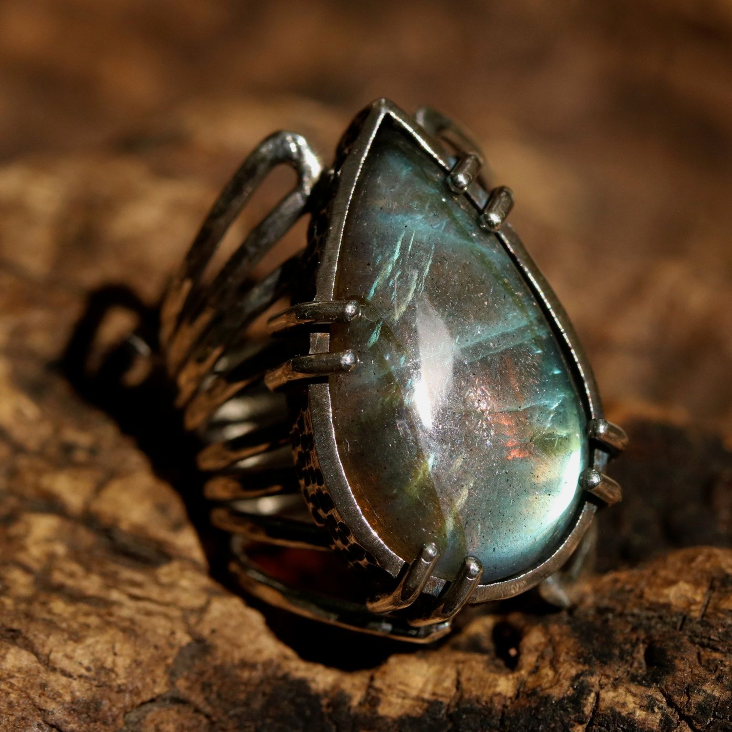Round faceted labradorite ring in prongs setting with sterling silver oxidized texture band