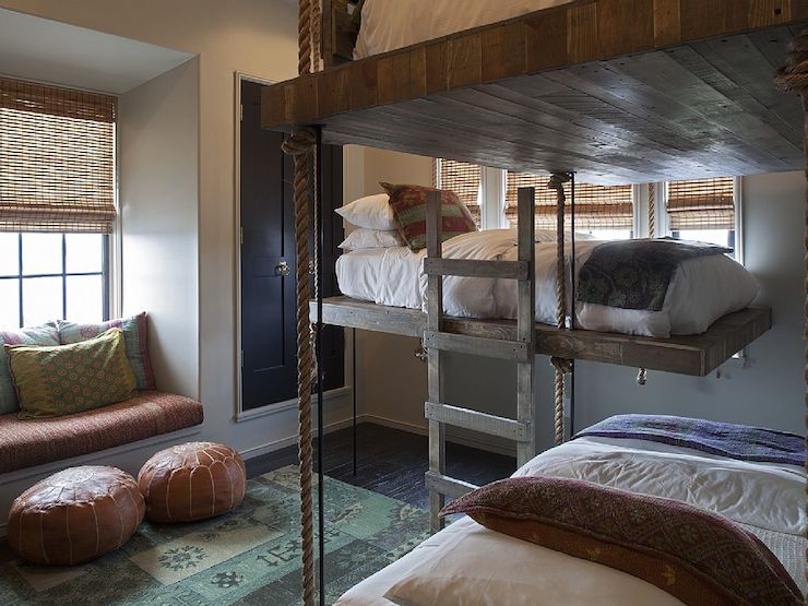 Mediterranean boys' room features two sets of floating rope bunk beds mounted on walls covered in ...