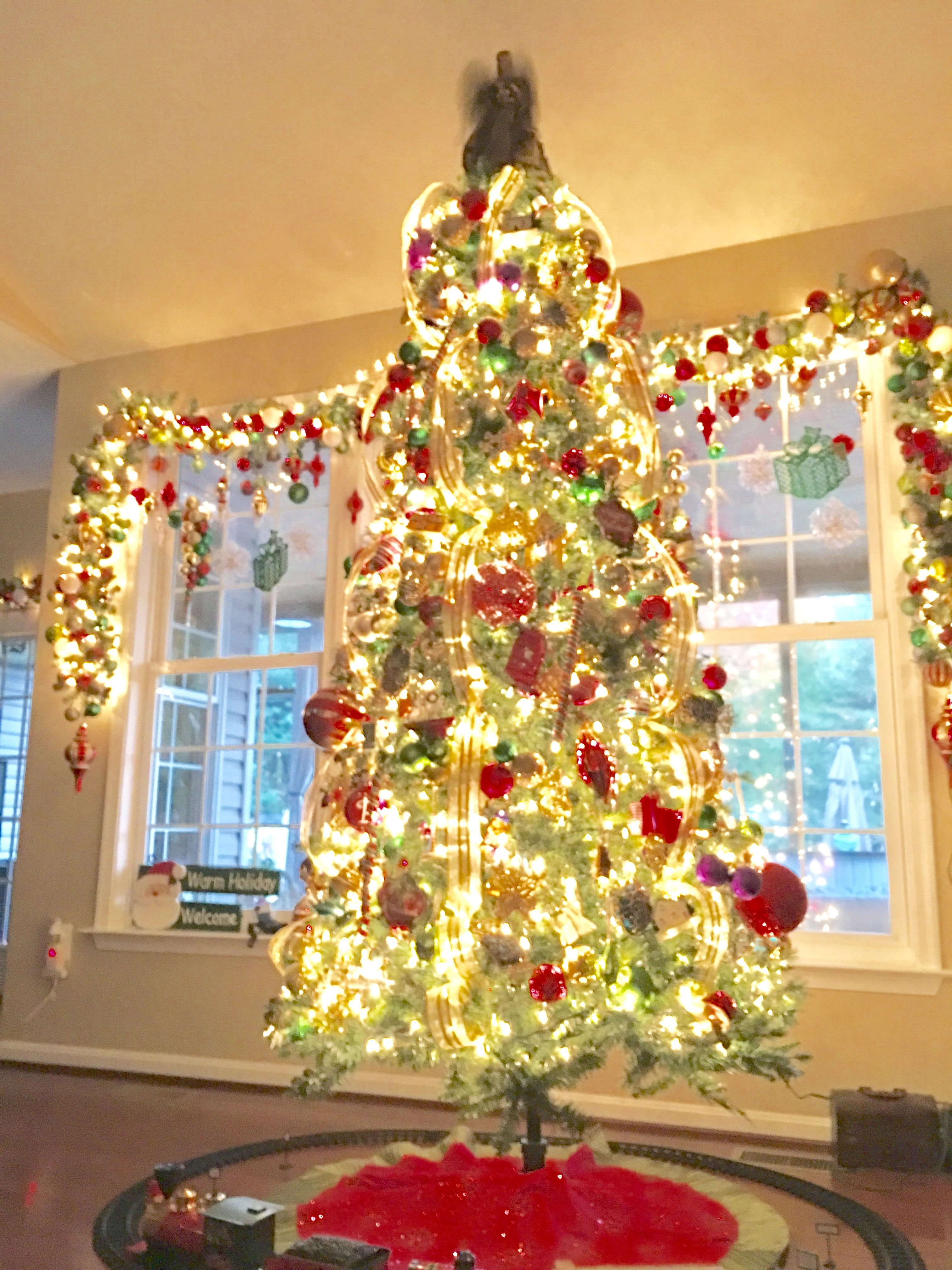 Christmas Tree with Vertical Ribbon Christmas Garland on Window