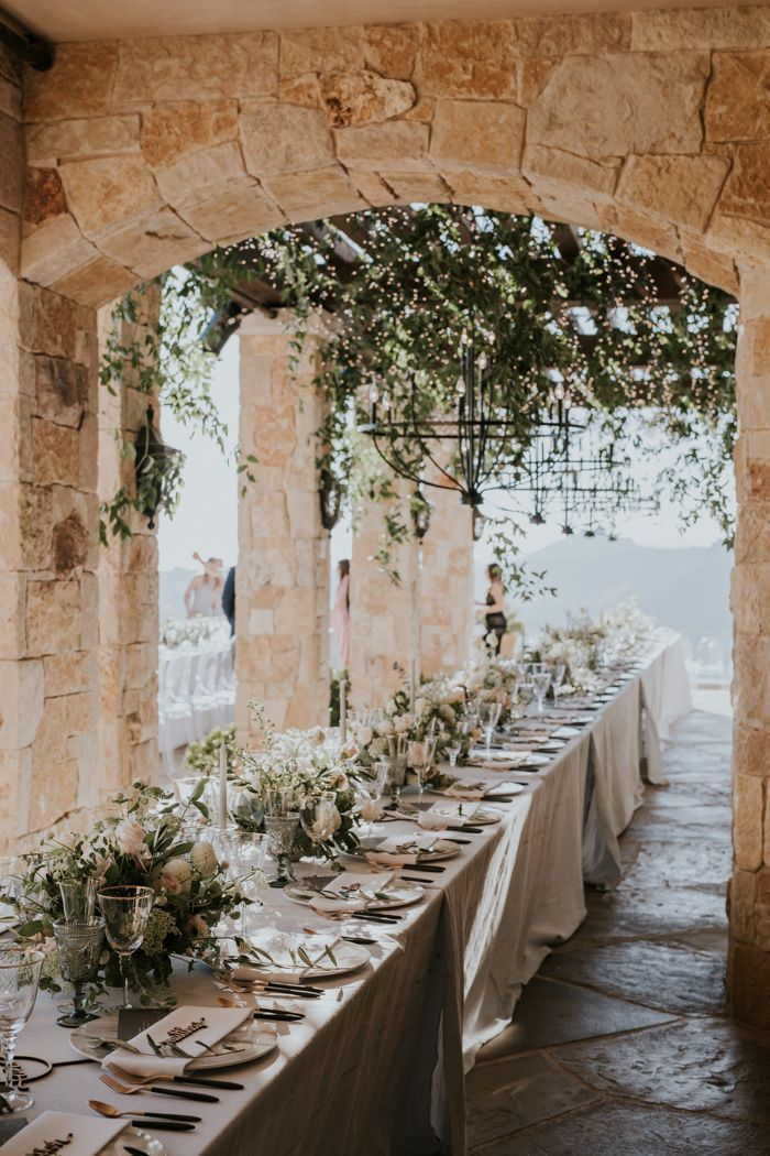 This outdoor reception features old-world stone architecture + plenty of greener...