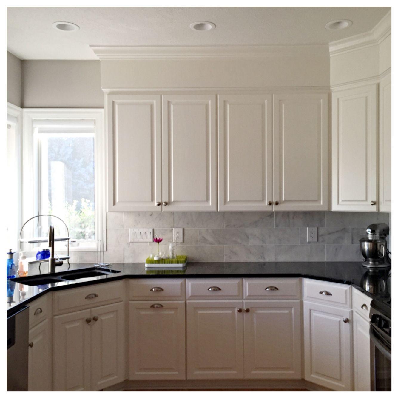 - White Marble Backsplash, Black Granite Countertops White Marble