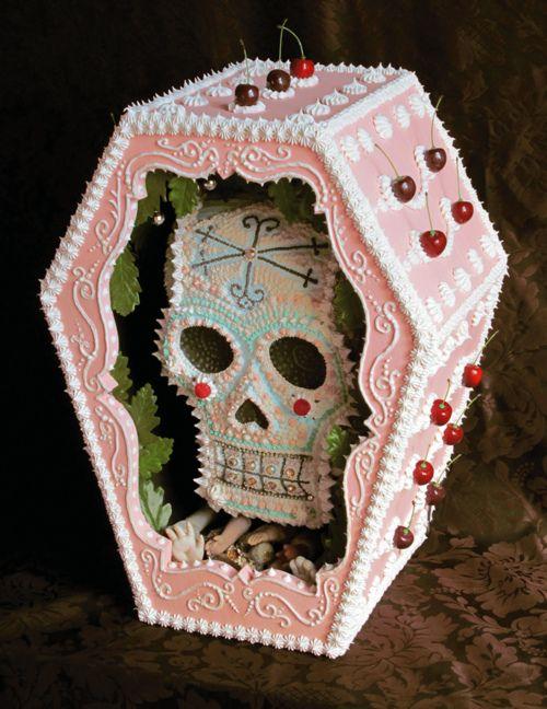 sugar skull in sugar coffin.