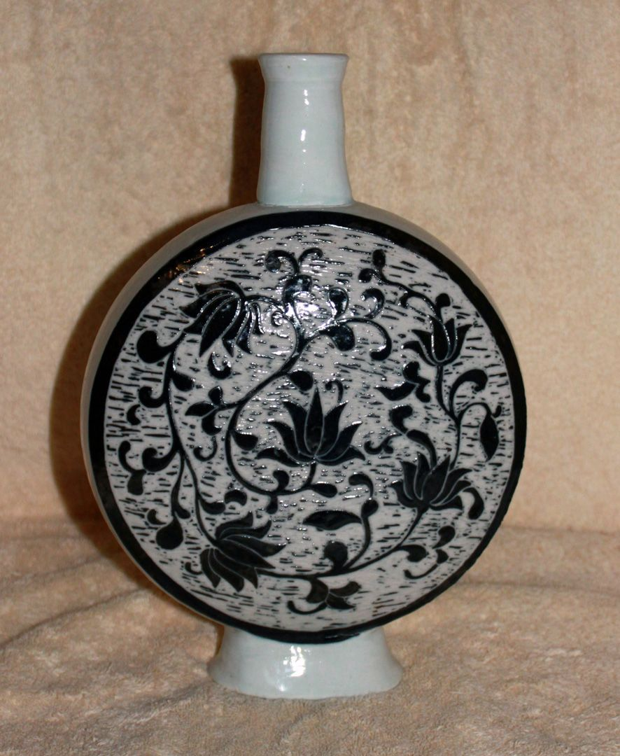 Porcelain moon flask with black slip scrafitto decoration by J Loer