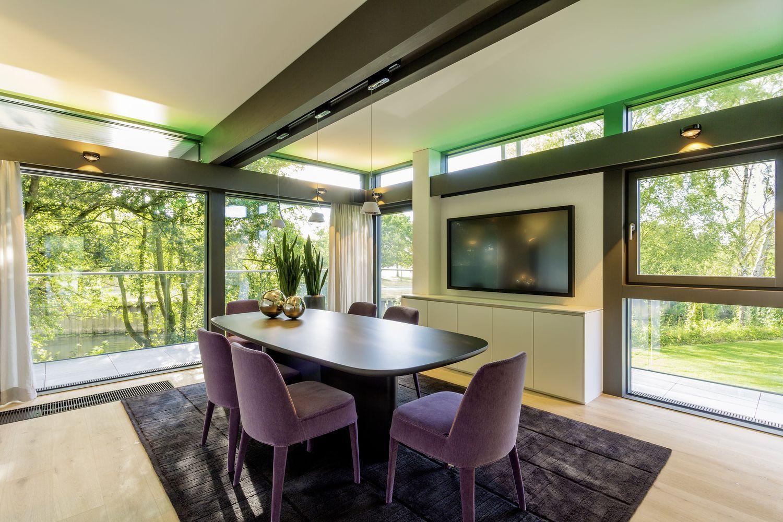 HUF Musterhaus Fertigbau Fachwerk aus Glas und Holz progressives ...