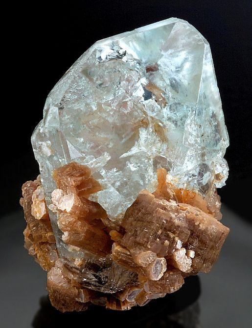 light blue Topaz perched atop Lepidolite