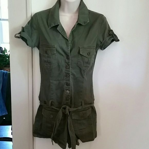 Hot Kiss army green romper Sooo cute and sexy! Army green woth buttons and pockets and tie in front. It has a bit of stretch to it. Super sexy when on. Wore with combat boots but goes with sandals, slip on etc. Cotton/spandex mix. Size M but it is on smaller end. I think it would fit a S as well. Only getting rid of because it is just a smidgen too tight. It's killing me! Hot Kiss Other