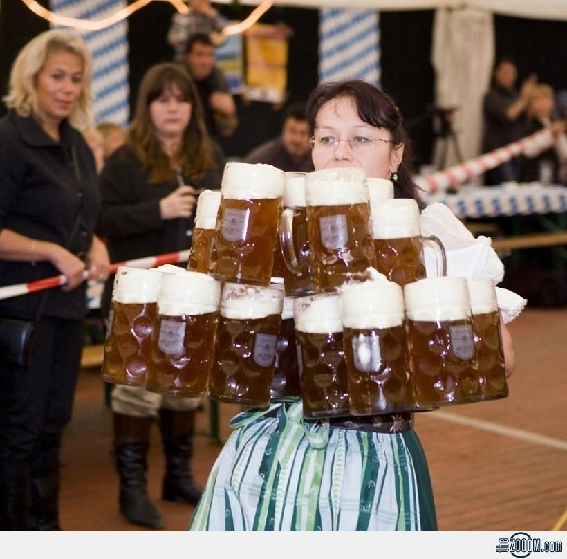 Wow! Оktoberfest. The girl on hands transfers about 30 kilograms (14 glass mugs with beer). September 2013