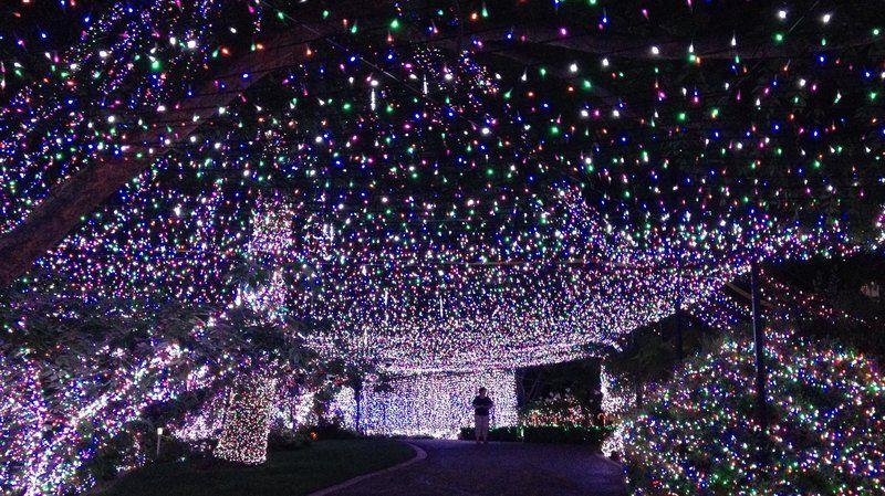 Ten Breathtaking Christmas Light Displays From Around The World Christmas Light Displays Hanging Christmas Lights Christmas Lights