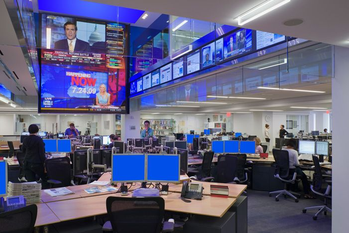 Dow Jones To Facilitate The Rapid Exchange Of Information And Ideas Within Media Hub A Giant Lcd Display Surrounded By Smaller Screens Line