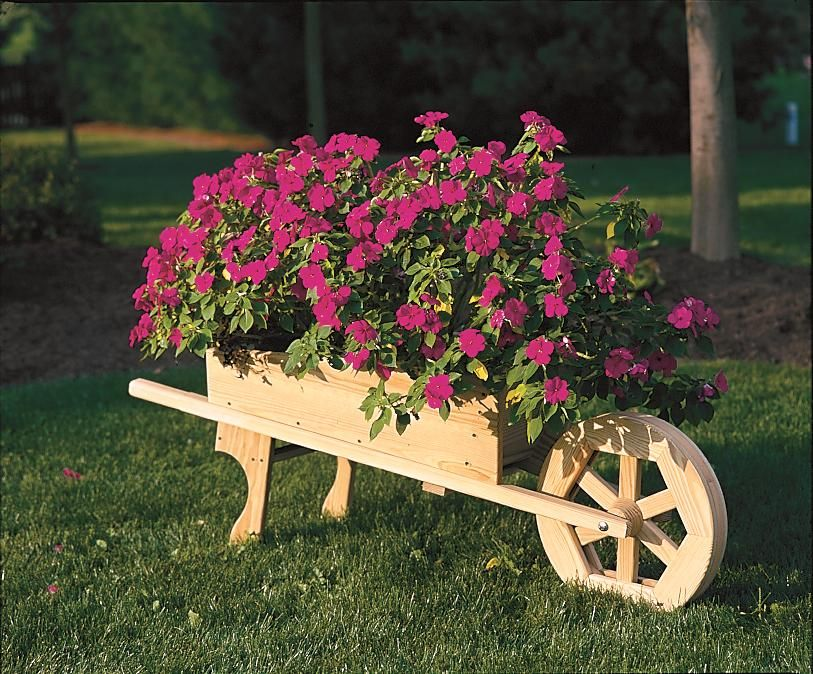 Wooden wheelbarrow on pinterest table plans petunias for Wooden garden ornaments and accessories