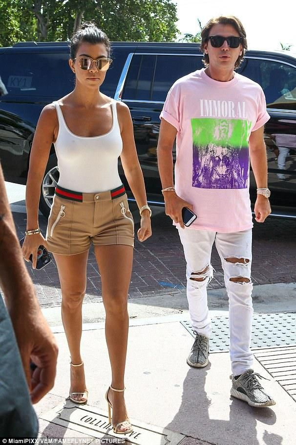 Kourtney Kardashian wearing Stuart Weitzman Nudist Ankle-Strap Sandal, Wolford…