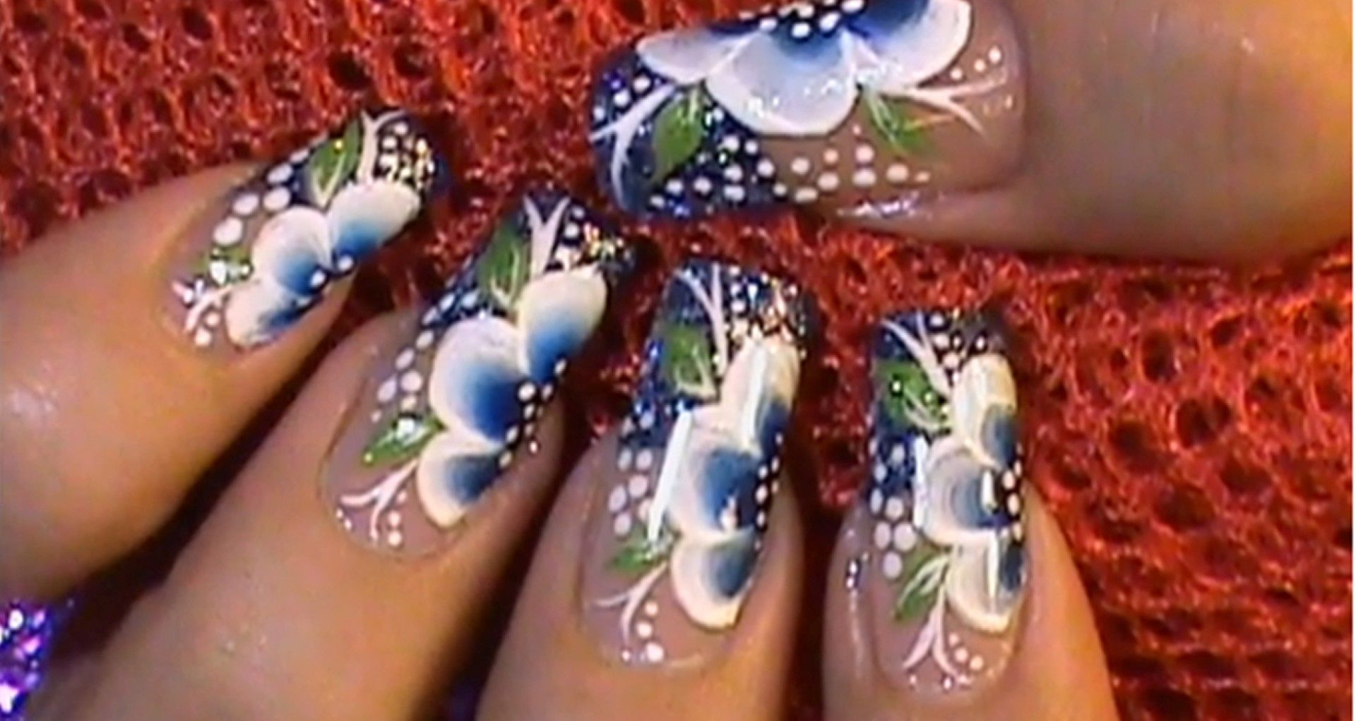 Nail Art Video Tutorial - One Stroke Blue Flower  Here is another great nail art design challenge for you. Play around with the colours, and create some interesting flower nail art designs. Have fun!  Follow the link Below for the video:  http://supermodelssa.co.za/nail-art-video-tutorial-one-stroke-blue-flower/
