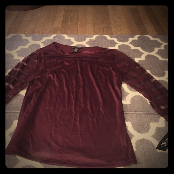 Size L petite maroon INC quarter sleeve top NWT NWT. I love this shirt but I have one in different color. It's a Petite large maroon color never worn. Sleeves have mesh and solid stripes. I.N.C.  65% polyester 35% polyester. I wear my other to work and with jeans! I love the sheer on the neckline! INC International Concepts Tops