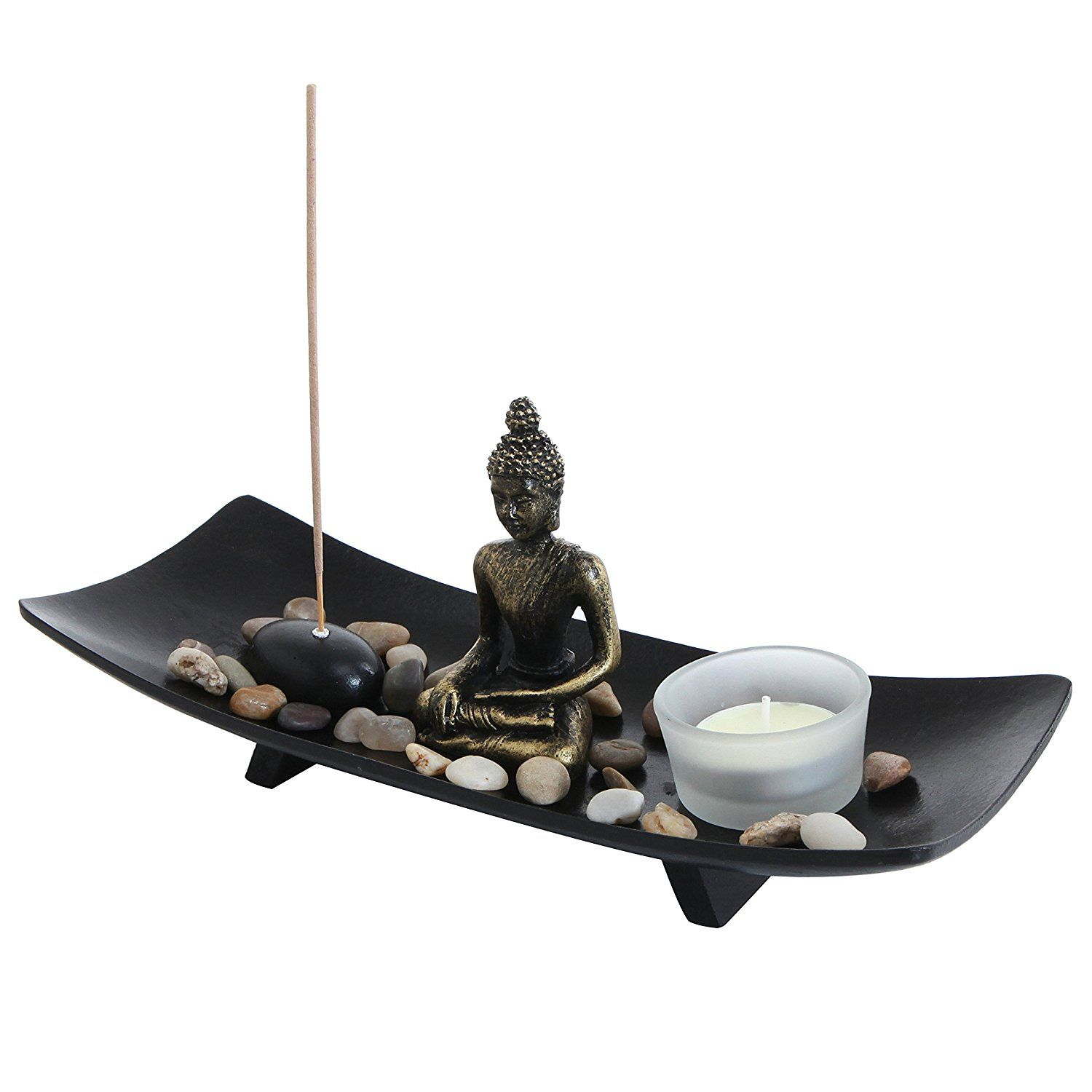 Zen garden buddha statue with glass tealight candle and incense