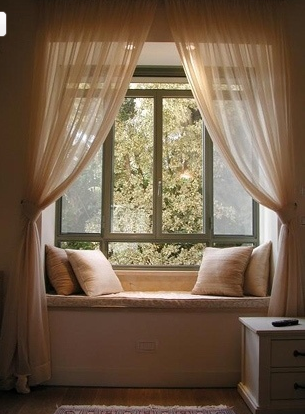 I wonder if curtains like this would work for the window seat space in our nursery?