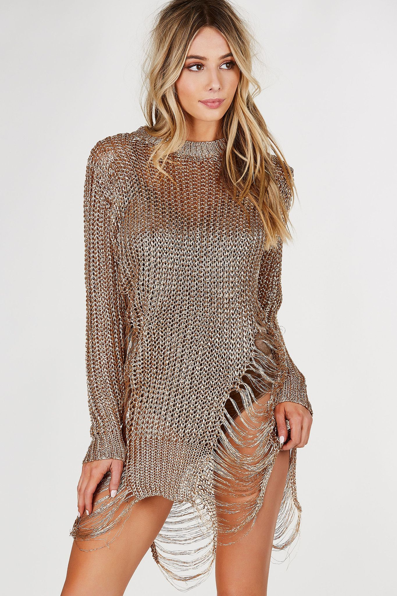 Crew neck loose knit tunic with metallic finish. Shredded detailing with relaxed fit. - 100% Polyester - Imported - Model is wearing size S-M - Runs true to size - Dry clean recommended - Also availab