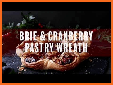 Golden puff pastry wreath filled with sweet cranberry sauce oozy Brie cheese an  Golden puff pastry
