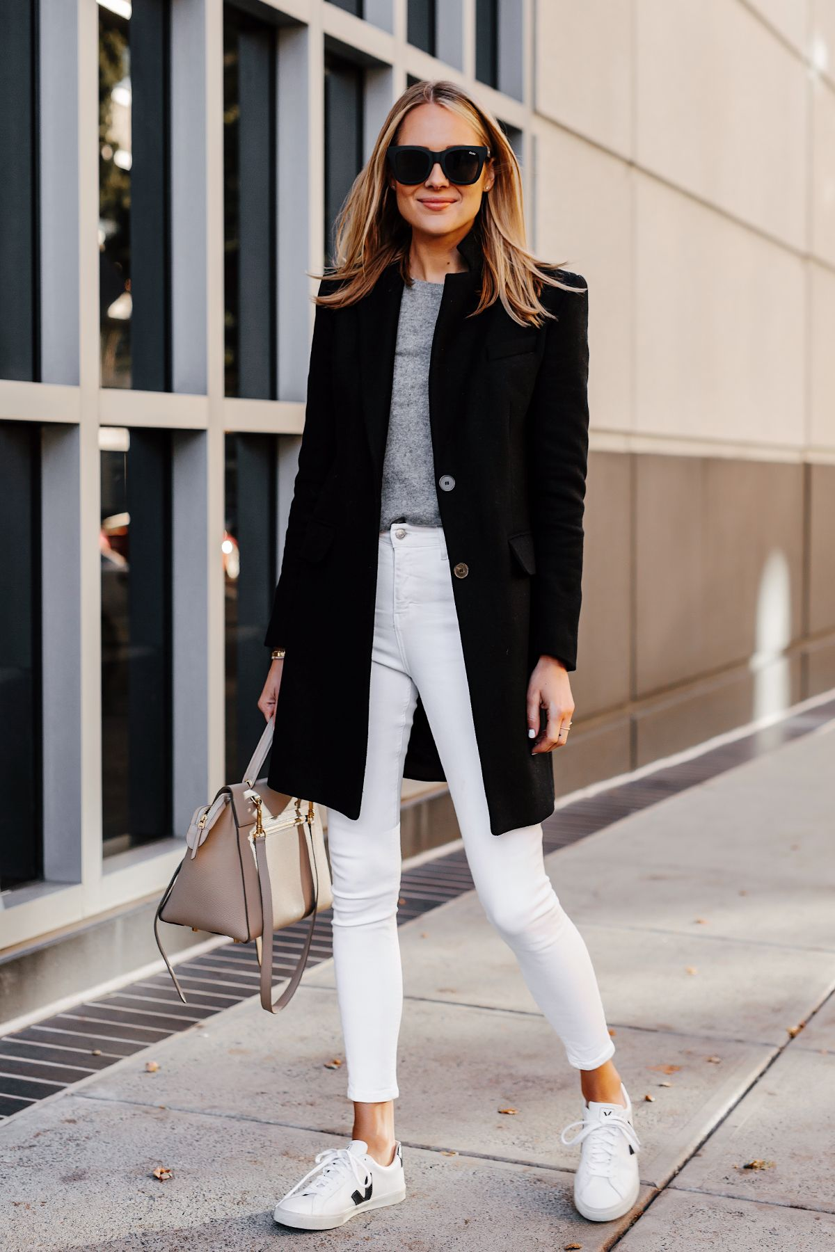 a102f3edfa221 Blonde Woman Wearing Black Wool Coat Grey Sweater White Skinny Jeans Veja Sneakers  Celine Mini Belt Bag Fashion Jackson San Diego Fashion Blogger Street ...