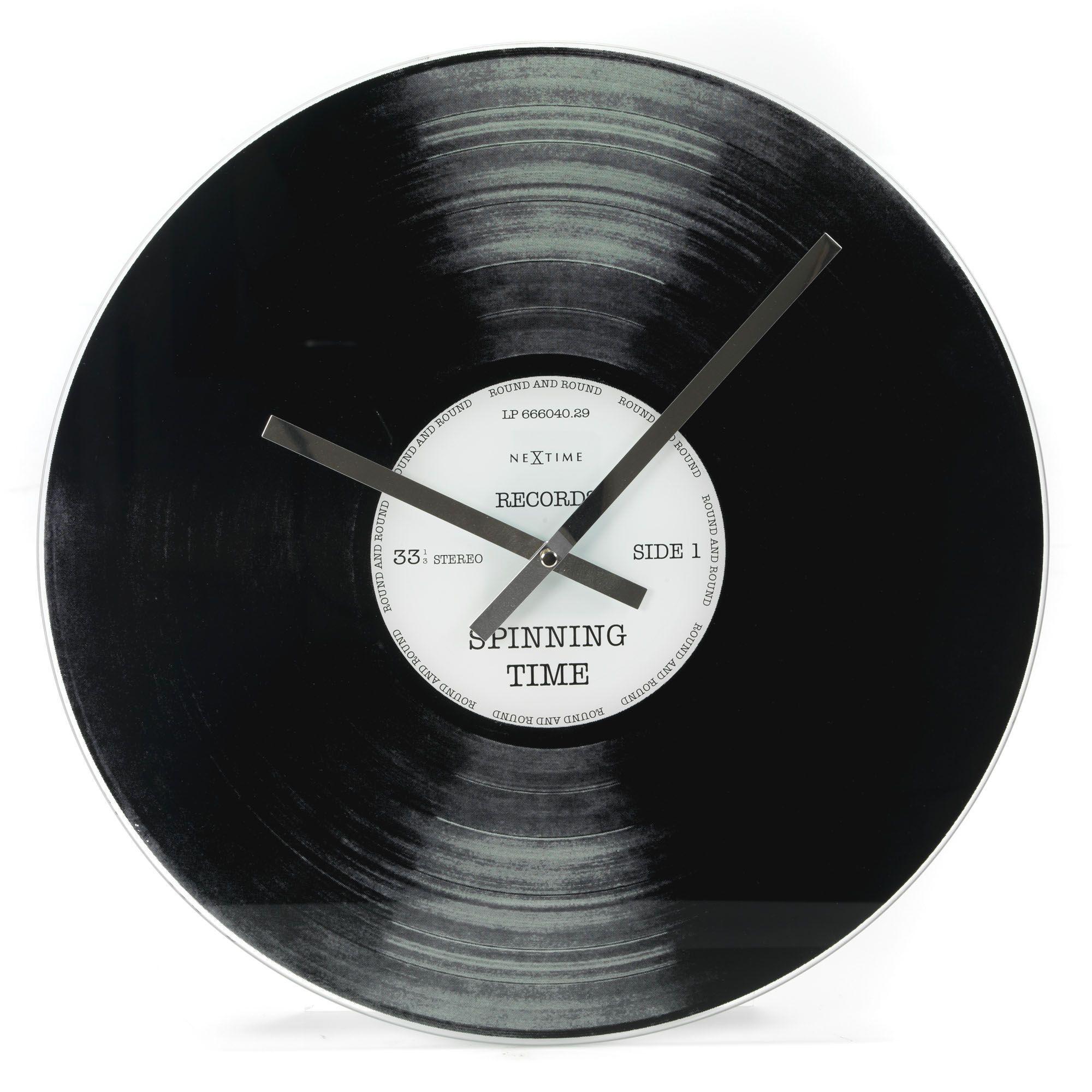 grande horloge murale 43cm de diamètre noir blanc spinning