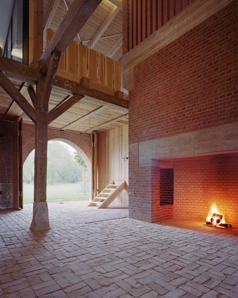 Brick and timber detailing fireplace archway modernised industrial architecture landhaus thomas kröger architekt