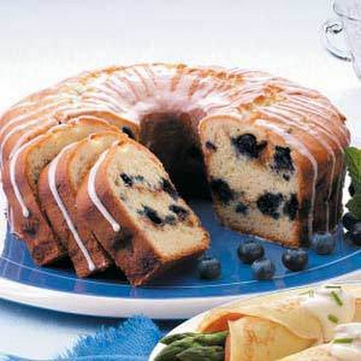 Blueberry Sour Cream Coffee Cake Recipe Lunch and Snacks, Breakfast and Brunch, Breads with butter, sugar, eggs, pure vanilla extract, all-purpose flour, baking powder, baking soda, salt, sour cream, brown sugar, all-purpose flour, ground cinnamon, frozen blueberries, confectioners sugar, 2% reduced-fat milk