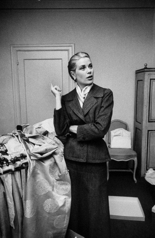 Grace Kelly takes a momentary breather while packing her things before the wedding, 1956