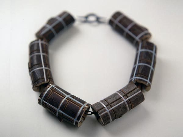 Terhi Tolvanen, Chanel 2006. Necklace Ø 19 cm. Silver, steel, wood, textile. Collection Rotasa Foundation.