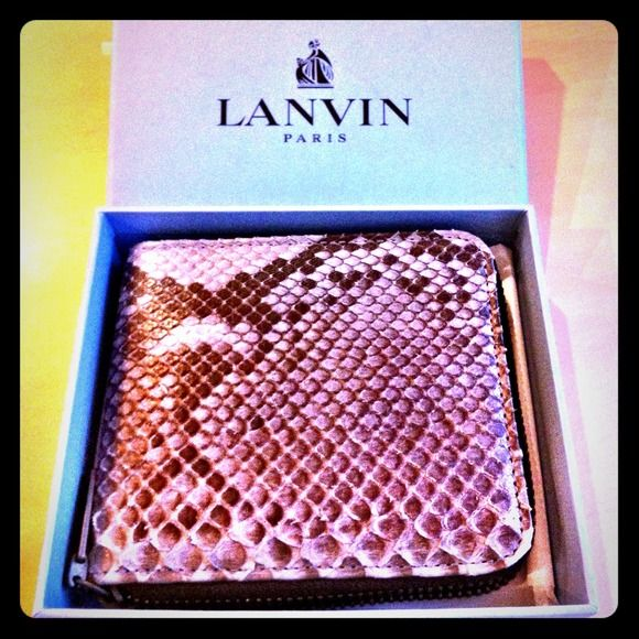 "Lanvin Python Wallet for sale Brand new beautiful Python bill fold wallet with change pouch, 4 card slot holders. Inside is made of smooth dark leather. Approx: 4""-5"" (inches) Lanvin Bags Wallets"