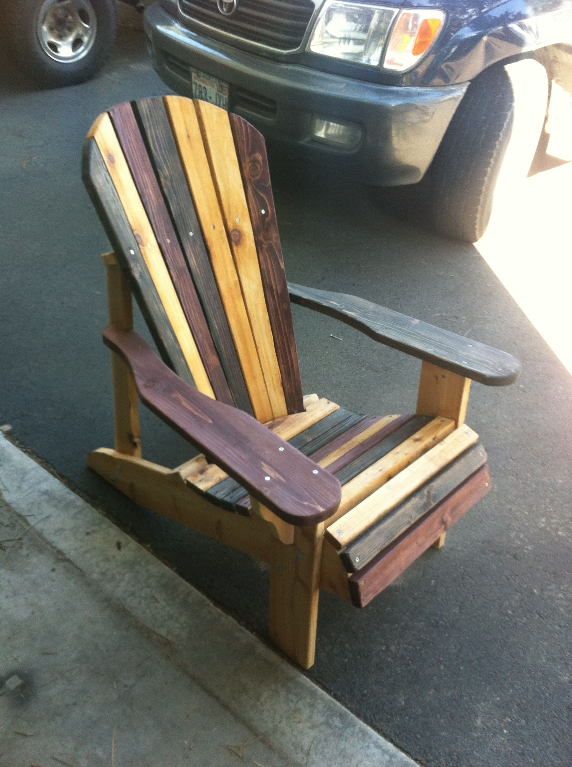 Adirondak chair with three different stains. Adirondack